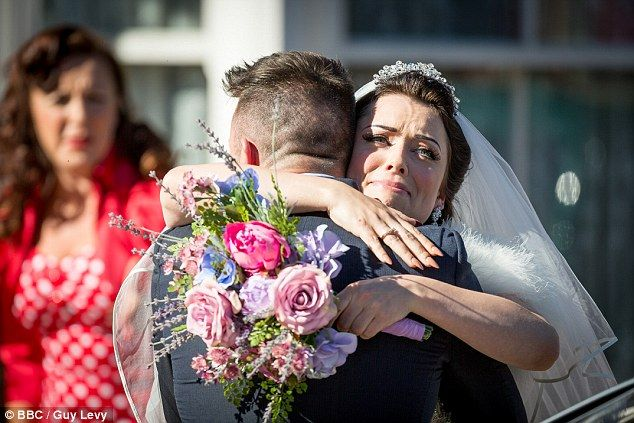 Tears of joy: Ryan Malloy causes a stir when he returns to surprise his half-sister Whitney on her wedding day