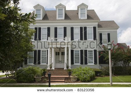 Stock Photo Two Story Colonial Style Home With Shutters
