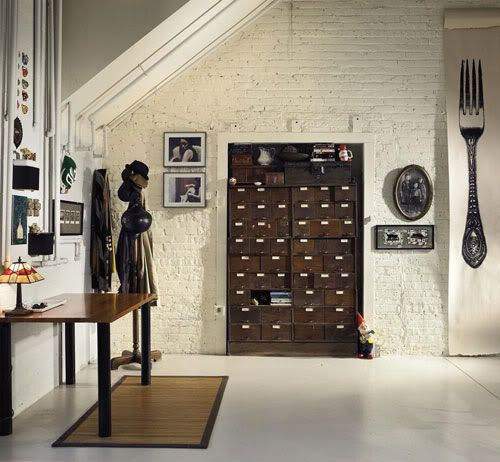 Index card cabinet, dark brown wood in white light colored wall