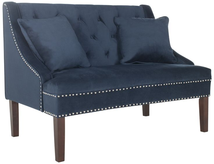 This modern settee was inspired by the contemporary renovation of a Victorian bed and breakfast tucked into the hills of San Francisco. Ideal for any room, its navy upholstery features luxurious nail head trim and tufted button detail. The settee measures 49