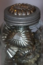 vintage molds in canning jar.  One in the top ring also!  So pretty with vintage cookie cutters as well!