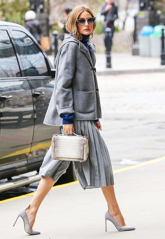 Olivia Palermo in a grey coat + blue turtleneck sweater + grey pleated culottes + grey heels