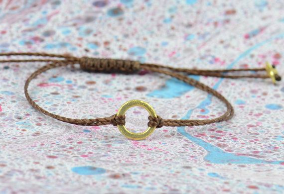 Karma Bracelet This one is made on vermeil,silver plated with 24k gold with waxed thread. The circle has a scratchy look. This is made in brown waxed