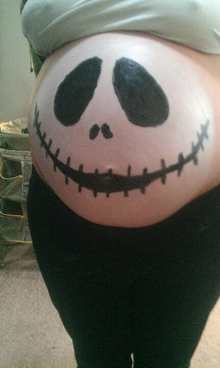 10-31-11  due 12-19-11  My husband painted my baby belly  for Halloween :)