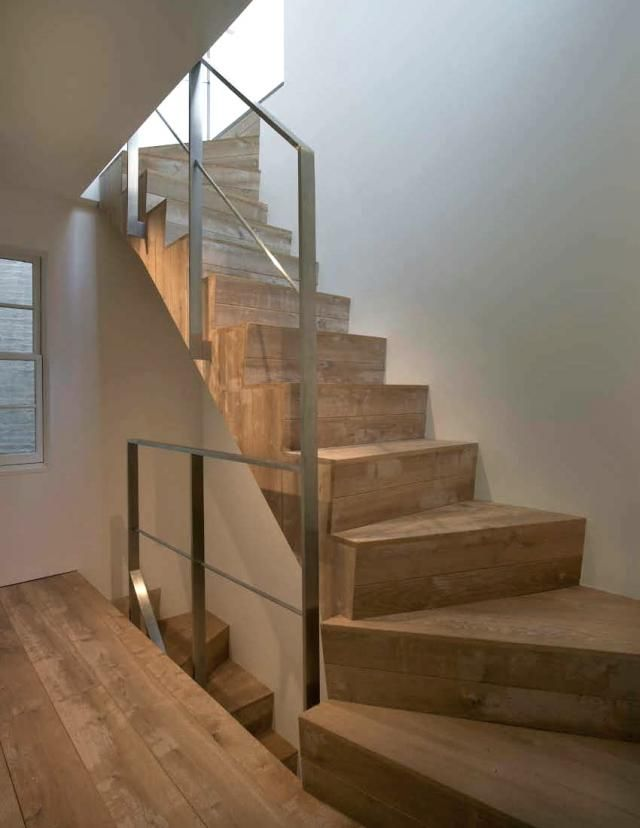 new oak floors and stairs - wire brushed and lime washed for a worn look. photo by michael eastman.