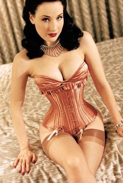 Dita Von Teese in stunning peach corset