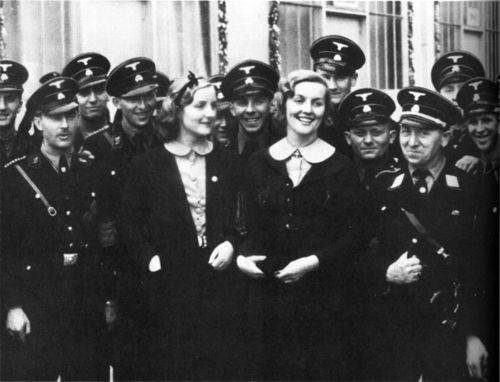 Diana Mosley (née Freeman-Mitford) and Unity Mitford photographed with members of the SS, 1937