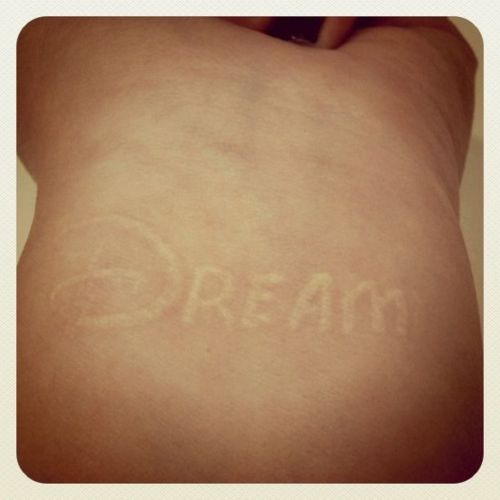 DISNEY dream tattoo!! This one is in white ink, but I would get it in multiple colors! :D