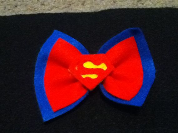 Superman hair bow! pretty for girls at a super hero party :) and spunky adults too ;)