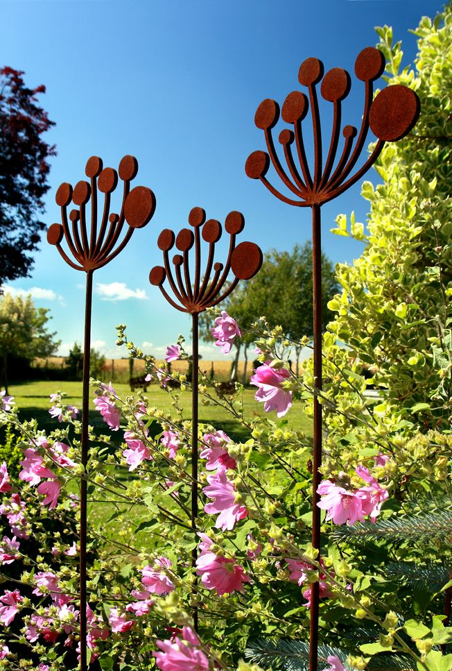 Cow parsley garden sculptures crafted from rusted metal on a bright and sunny summers day.