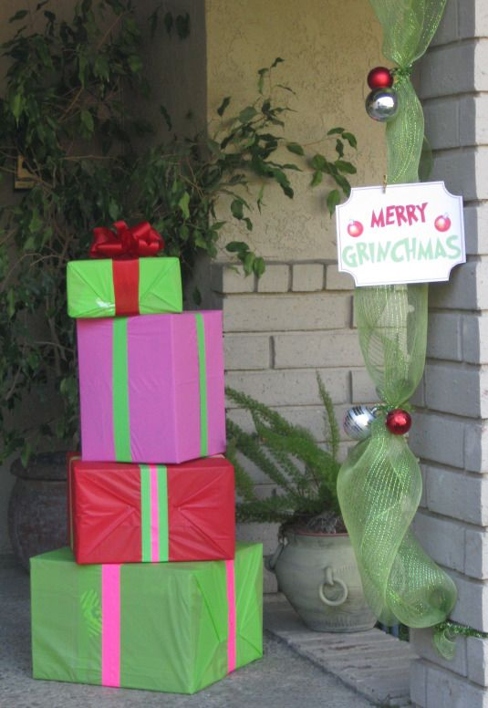 Grinch Party Entrance. Love the tulle door frame.  Use outdoor table cloth on packages ri
