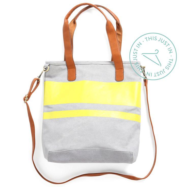 This Just In! Swap out your neutral tote for a zest of color. We love the durable (and easy-to-clean!) grey canvas with a pop of lemon-lime stripe. (Kasen Colorblock Canvas Tote)