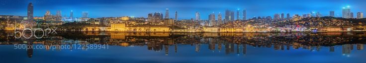 Panorama of Istanbul and Bosporus at night by VasylOnyskiv