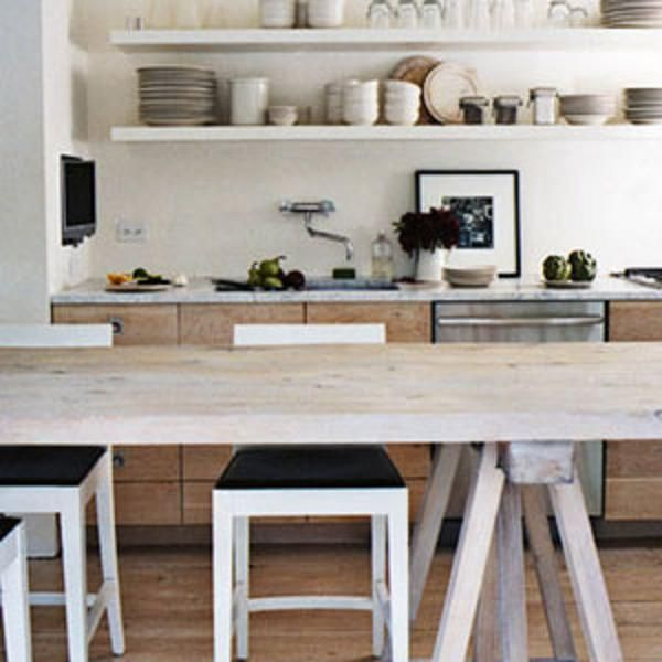 The centerpiece of the kitchen is a 16-foot-long table on sawhorse trestles by Tim Bell. Open shelving holds white and cream restaurant supply dinnerware. Betsy Brown . http://www.housebeautiful.com/design-inspiration/house-tours/advice/g178/neutrals-are-crisp-0907/