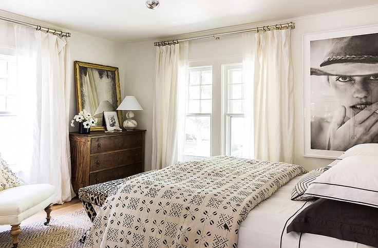 An antidote to the moody master bedroom, the guest bedroom is airy and creamy, with layers of textiles.