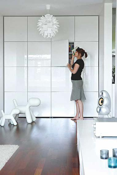 Ikea Besta units - I love the idea of a complete wall of units.Could be used in any room including a kitchen or playroom. The glossy finish reflects light back into the room and would hide a multitude of clutter. Great idea as they are not that deep and wouldn't take up much space. Placed floor to ceiling as shown makes it look built in and a lot more expensive than it actually is.