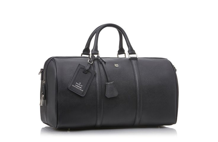 Introducing the Weekender 45 duffle bag. Handmade from Italian saffiano leather, the Weekender 45 is the ultimate travel companion.