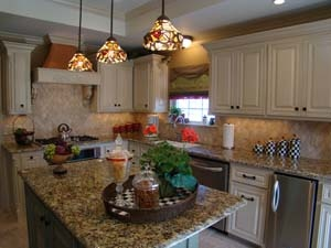 Gorgeous kitchen - love the copper hood and diamond tile backsplash
