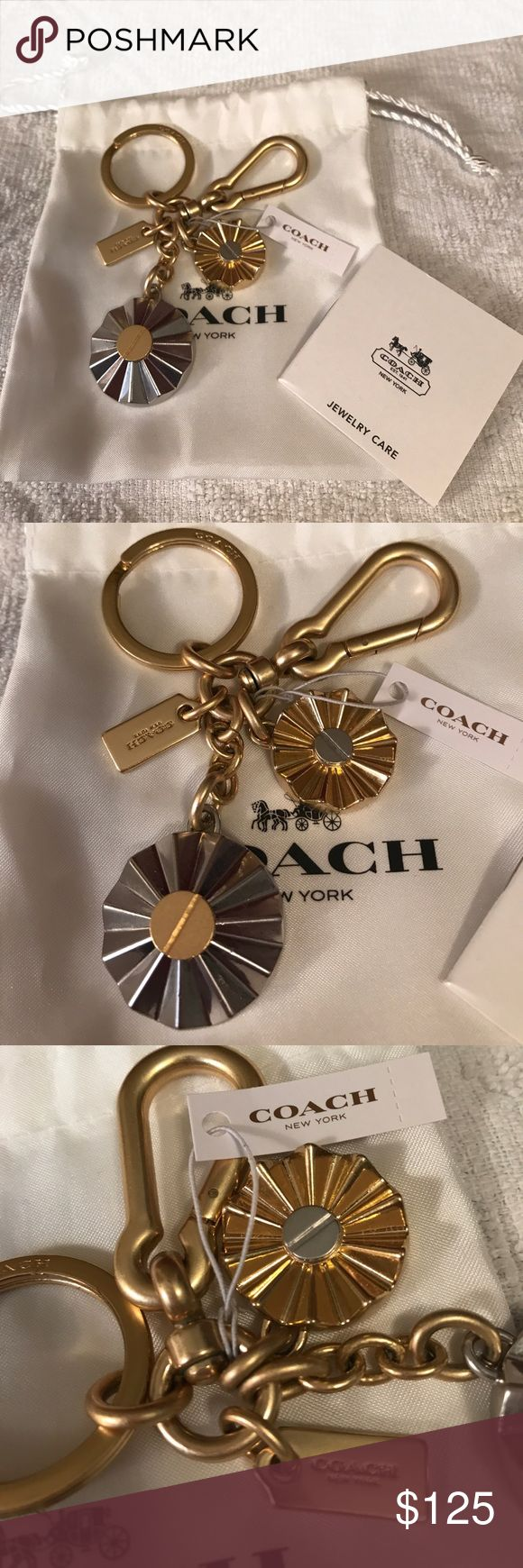 Coach Daisy Rivet Gold & Silver Key Chain Fob🎁💐 Coach Daisy Rivet Gold & Silver Key Chain Fob🎁💐 brand-new with tag, comes with dust bag and jewelry care book. I bought this at coach.com online. They do not sell these anymore so this becomes RARE now I can't find it anywhere on the Internet. You can use this on your handbag hang it on your purse or any bags you have will bring class and elegance. Comes from a non-smoking home pet free. I ship Monday Wednesday Friday. Coach Accessories Key…