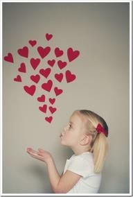 Great picture idea-- put hearts on the wall, and then have each child pretend to be blowing a kiss!