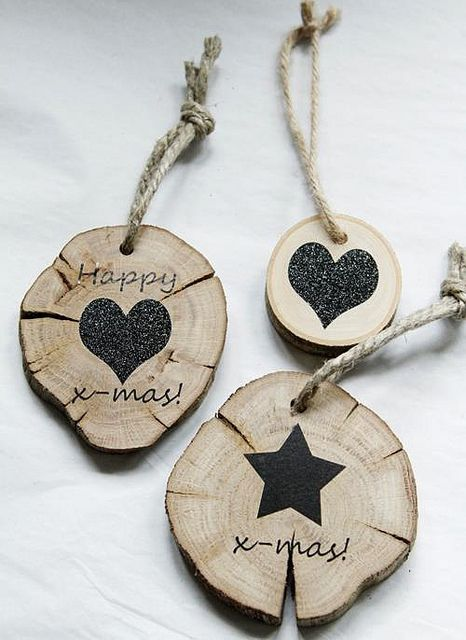 DIY Christmas ornament inspiration. Circles of wood, bark intact, are painted (simple shapes are easiest but anything is possible!) and a small hole drilled for ribbon, leather or twine for hanging. Thinner circles could be used as gift tags.