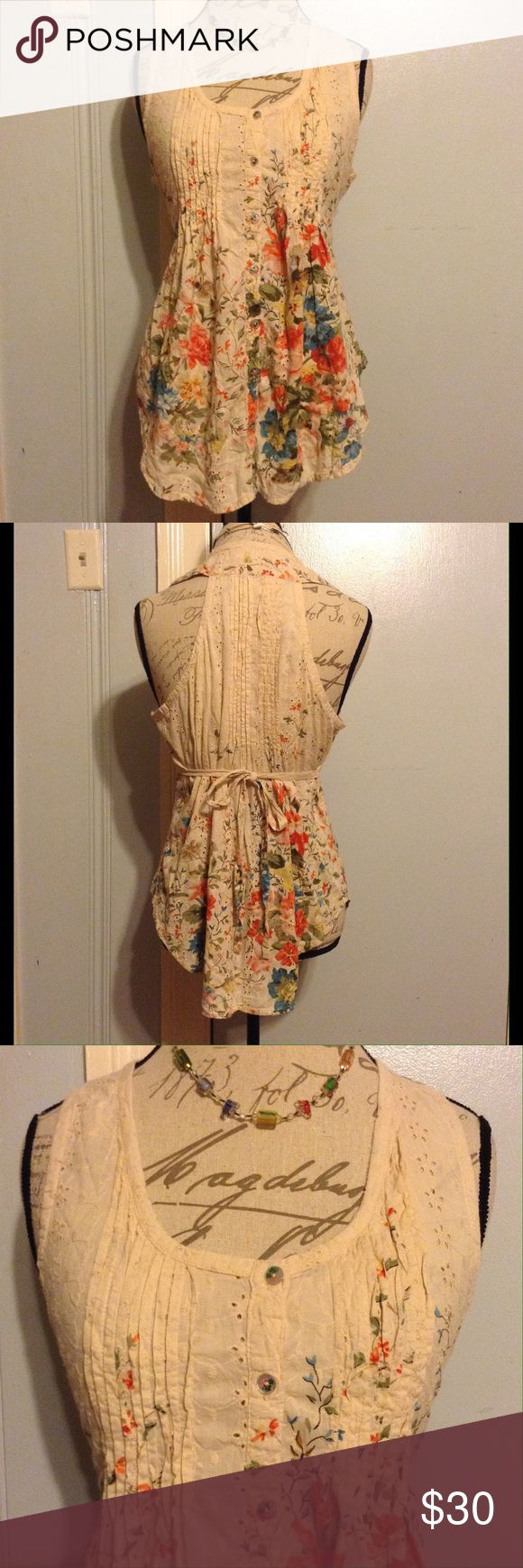 "AMERICAN RAG Cream Razorback Floral Tie Back Top SIZE 18.5"" Sides Length. 24"" Front & Back Lengths. Scoop Neckline. Button Down Center. Pleated Grooves & Flower Hole Cut-Outs w/ Embroidered Flowers & Vines. Sewn Tie Back From Sides. Extra Fold & Pleat For Back Structure. Boho Chic. Mat Tag Miss. EUC WORN ONCE American Rag Tops Button Down Shirts"