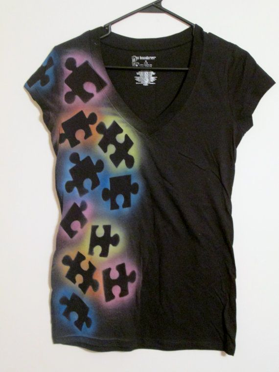 you can lay puzzle pieces down on the shirt and then spray paint over it and wait to take the pieces off until it is dry it looks cool