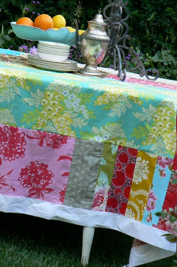 Use Of Fabric Scraps To Make Beautiful Bright Patchwork Tablecloth