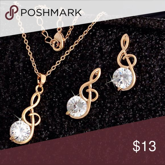 """MUSIC CLEF NECKLACE & EARRINGS Sweet gold plated necklace with music clef holding a clear rhinestone and post earrings. Dainty gold chain is 16"""" long with a 2"""" extender. The music pendant & earrings are 1"""" long. Jewelry Necklaces"""
