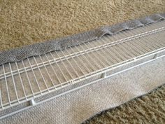 "A PET RAMP FOR BOO Pet ramps are expensive! I looked at the cost of these things and thought that $100.00 to $180.00 was too much to pay so I thought that I'd design my own with common items found at Home Depot. My intention was to be able to use the ramp to get our Shar-Pei, Buster (otherwise known as ""Boo"") in and out of our pickup truck so that he could have some relief from his tennis elbow and not have to deal with the constant impact on his joints. My dog is a darned good tenn..."