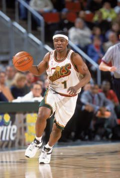 Shammond Williams of the Seattle SuperSonics dribbles the ball during the game against the Houston Rockets at Key Arena in Seattle Washington The...