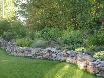 want a raised bed with rock in front of the patio in the front yard