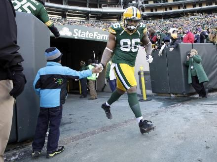 GB Packers LB Mike Neal slapping hands with a young fan. (Green Bay Packers: Football News, Photos, and Videos | Milwaukee Journal Sentinel - JSOnline)