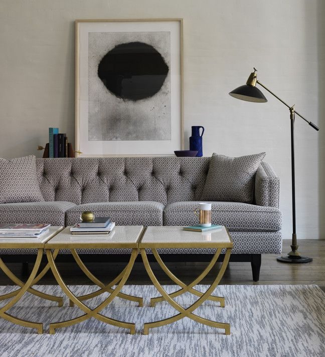 Grey Grandeur: a tufted sofa in the Living Room.