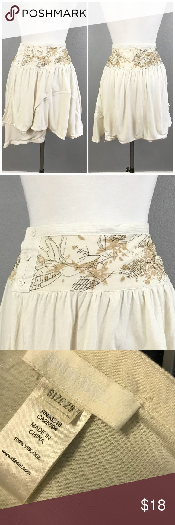 """Diesel Ivory Boho Wrap Asymmetrical Hem Mini Skirt Diesel Ivory Boho Wrap Asymmetrical Hem Mini Skirt. Size 29. Thank you for looking at my listing. Please feel free to comment with any questions (no trades/modeling).  •Waist: 32"""" •Length: 21"""" •Condition:  VGUC, no holes or stains.   25% off all Bundles or 3+ items! Reasonable offers welcome.   BIN: LA Diesel Skirts Mini"""