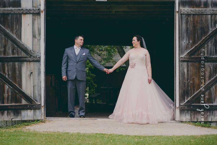 Bride and Groom in a barn doorway