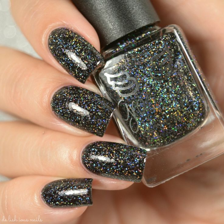 Deep Dark Magic has a black jelly base and is packed full of silver and black super holographic glitter – it's a super sparkler.Nitty gritty:*Your polish comes in a 11ml bottle, with a wide e...