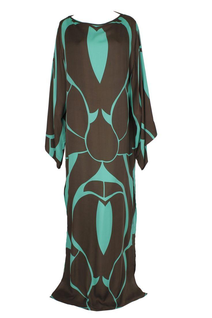 A floor-length boat neck dress with a mint and brown circular print and draped sleeves by Plein Sud #pleinsud #eveninggown #ramadan #print #draping #luxury #gbmoda #hautecouture #greenbird #fashion #trend #dubaifashion #abudhabi #marinamall #elegance