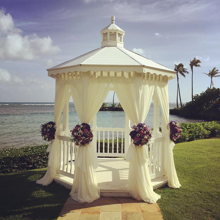 """What a gorgeous day for a wedding at The Kahala Hotel!  Loving our ballerina chiffon gazebo draping & gorgeous blooms by @floristgrandinc!"""