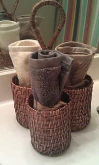 DIY toothbrush holders from wash rags with pocket for each person's toothbrush and toothpaste.