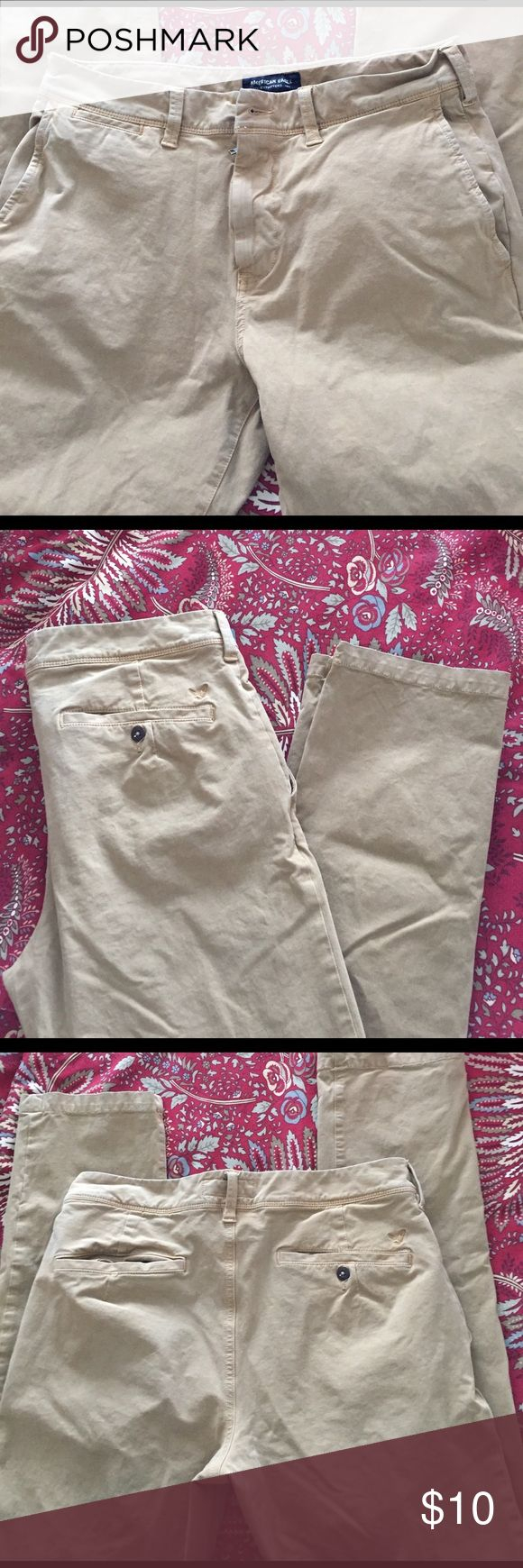 American eagle men's khaki pants slim fit 32x34 American eagle men's khaki pants slim fit 32x34.  Color is more yellow than beige reflected in last pic.  Straight leg slim fit. Front pockets flat front look.  Great condition American Eagle Outfitters Pants Chinos & Khakis