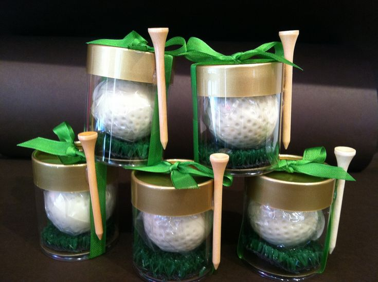 Chocolate Golf Wedding Or Party Favors White Filled With Creamy Dark Hazelnut Rests On A Bed Of Gr Side