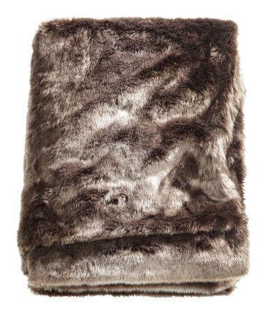 H&M Faux Fur Throw, $80. Because who wouldn't want to wrap themselves in (faux) fur?