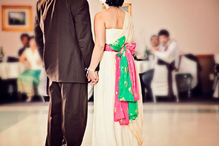 I totally stole this from Dia, but I just LOVE the idea of the incorporating the Hmong sashes into a wedding dress