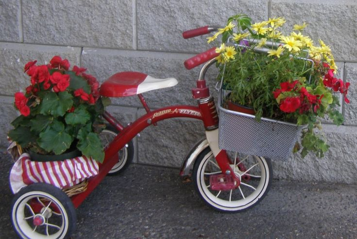We love the adorable way this project utilizes the built-in baskets of the Radio Flyer tricycle to make a fun and fresh look. Instead of an old, restored tricycle, it utilizes a bright new one, but if you're going for this specific look or you don't have access to something more used, it's perfect. Fill the baskets with your own smaller container gardens or plant directly in them.