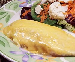 White Fish in Cheese Sauce - Make a creamy cheese sauce, pour it over fish and bake for an easy and delicious seafood dinner.