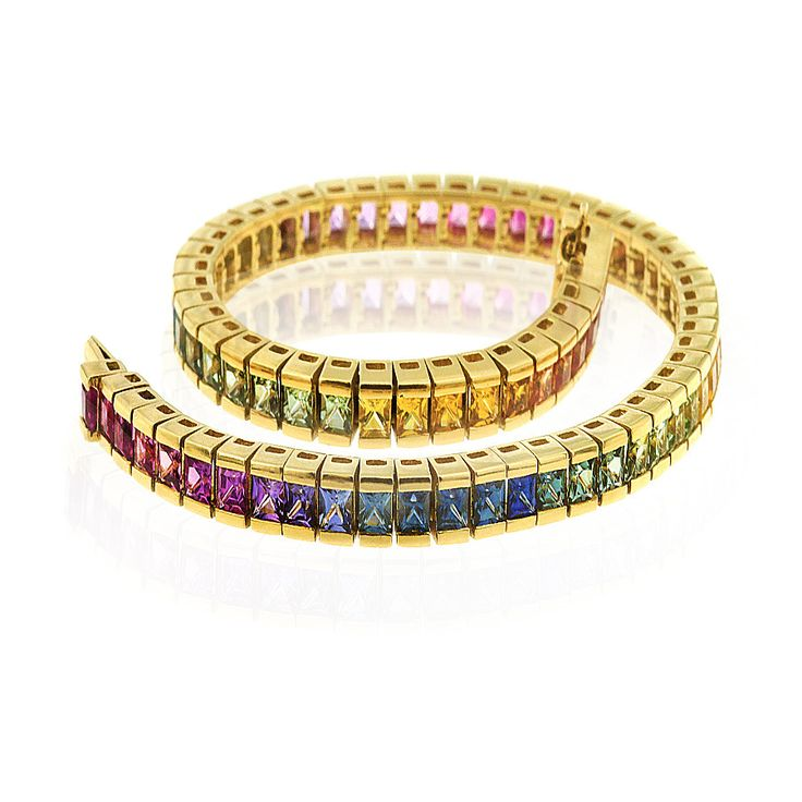 Colour your world with this vibrant Kaleidoscope sapphire bracelet incorporating varying shades of blue, green, pink, yellow and orange gemstones. Crafted in 18ct yellow gold. Length 19cm. Width 4mm.