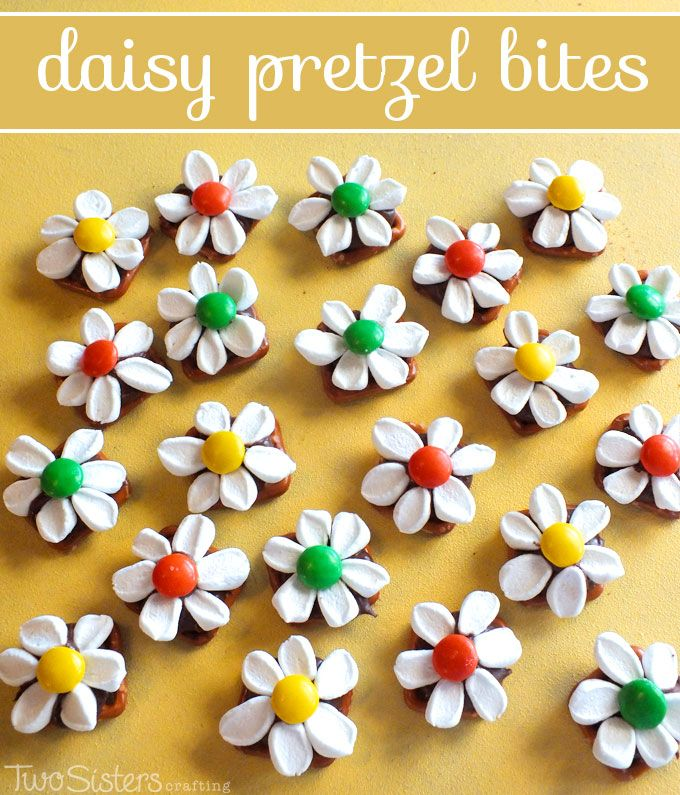 Daisy Pretzel Bites - made with pretzels, Hershey Kisses, Marshmallows and MM's.  Looks like a daisy but tastes like a s'more! For more fun and tasty pretzel snack ideas follow us at http://www.pinterest.com/2SistersCraft/