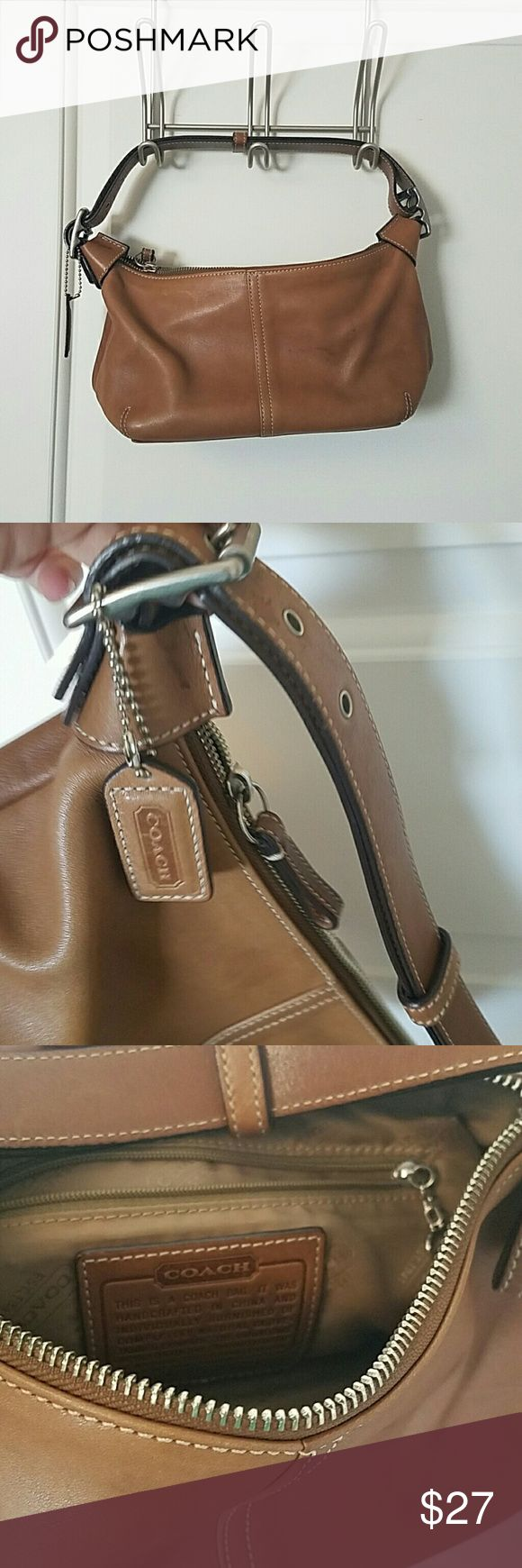 Coach hobo shoulder bag Brown Coach shoulder bag in good used condition.  A few minor scuffs as shown in photos. Coach Bags Hobos