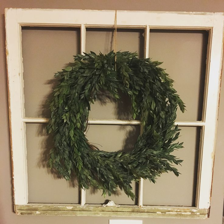 When you can't find a green wreath that you like that's affordable, you make one yourself! Made from supplies at hobby lobby. Cost 3.99 for the wreath (had a 40% coupon), and floral stems were 50% off (each cost 9.99 originally), plus floral wire (2.99). So cost around $20 total :)